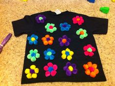 100th Day of School....100 Pom Poms glued to a t shirt