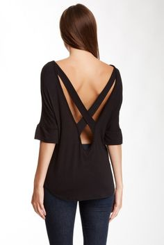 Simple shirt with elegant, open-back detail.
