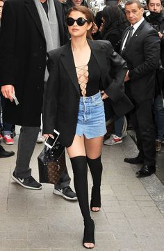 """Laced Up - The """"Good for You"""" singer worked her body from every angle in a lace-up Alexander Wang bodysuit, a denim Vetements miniskirt and Givenchy boots during Paris Fashion Week in March 2016. #selena #gomez #celebrity #style"""