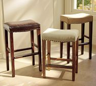 Kitchen stools...cover with a pillow top and fabric  then use the nailheads to  accent
