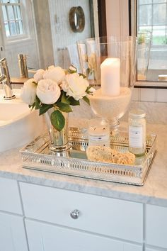 beautiful bathroom styling - flowers, candle, tray