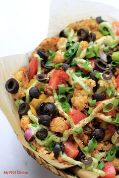 Loaded Paleo Cauliflower Nachos. These nachos are filled with your traditional nacho toppings, but use paleo-friendly ingredients! They are low carb, low calorie, dairy-free and gluten-free! The perfect healthy dinner!