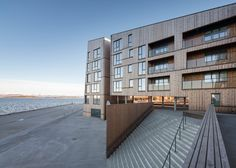 Faceted waterfront housing in Norway by AART architects | Designed by Danish studio AART architects and local firm Studio Ludo, the 19,500-square-metre Waterfront project is one of Europe's largest wooden residential developments – fitting for a city with the highest concentration of wooden buildings in northern Europe.
