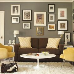 Brown couch and grey walls with white accents. I'll use blue as my primary color instead of yellow. I knew it would look good. This will convince him for sure.