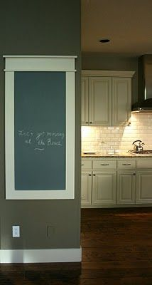 Add moulding to the wall to create a frame and then paint the interior with chalkboard paint.