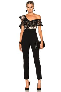 A contemporary and feminine black lace one-shoulder jumpsuit. Welt back pockets and faux welt front pockets. Sleeveless. Exposed back zip. Tan-colored lining. - Fabric: Basket weave / lace. - Shell: 75% polyester/21% viscose/4% elastane. - Trim 1: 100% polyester. - Trim 2: 97% polyester/3% elastane. - Dry clean. - Imported - MSRP: $388.00