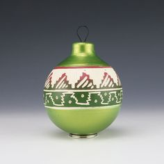 "This lovely pottery ornament was created by Navajo potter Vanessa Charlie.  Navajo pottery is is made through a process by which clay is poured into a mold, hand painted and hand etched by the potter, and then fired in a kiln.  Each piece of pottery is beautiful and unique.  Vanessa designed this pottery vase well, with attractive colors that compliment the etched design. 3  7/8"" tall x 2  5/8″ long x 2  5/8″ wide Artist card included"