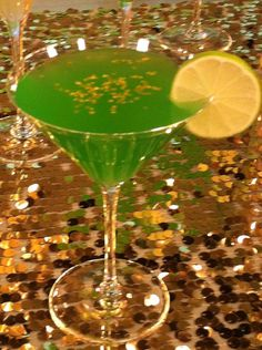Lucky Leprechaun   (•1 oz Midori Melon Liqueur  •1 oz Mailbu Rum  •6 oz Pineapple Juive  •Lime wedge for garnish)