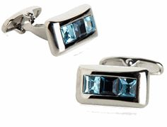 Three square-cut crystals are meticulously combined on each cufflink to create a true work of beauty. Complimentary colors of Aquamarine blu...