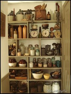 Antique kitchen items such as canning jars, mashers, butter paddles, butter molds and rolling pins fill this make-shift pantry. Primitive Homes, Primitive Kitchen, Primitive Decor, Kitchen Rustic, Antique Kitchen Decor, Primitive Shelves, Primitive Country, Old Farmhouse Kitchen, Vintage Kitchen Accessories