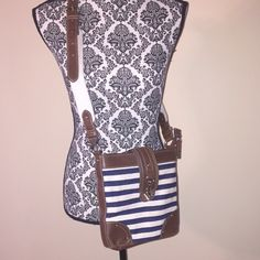 Chaps Crossbody Bag This bag has three separate compartments with two insides pockets and zipper closure. The bag also has a zipper and strap closure. Chaps Bags Crossbody Bags