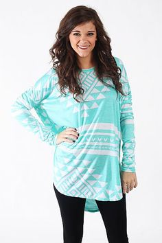 """Grand Canyon Tunic, Mint $36.00  You DO NOT want to miss this tunic! This super soft top has tribal patterns in beautiful colors, and we love the long length and dolman sleeves! Throw it on over leggings or skinny jeans for an outfit that's unbeatably comfy and cute, too!   Fits true to size. Miranda is wearing a small.   From shoulder to hem:  Small - 30.5""""  Medium - 32""""  Large - 33.5"""""""
