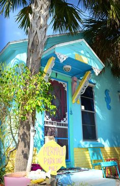 Blue and yellow cottage in Indian Rocks Beach, FL. - So cute! I lived there as a child, and now live 15 minutes away from Indian Rocks Beach. It is the least changed beach town around here!