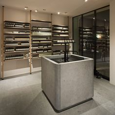 Van Duysen's interior design for skincare brand Aesop's Hamburg store features a large stone sink and ladder-like shelving made from oak and blackened steel.