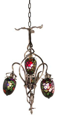"Continental Art Nouveau chandelier decorated with four extremely rare Fratelli & Toso ""murrine"" Italian glass shades set with in a organic silvered bronze chandelier. The shades are all decorated with highly decorated floral murrine decoration throughout all against a black background."
