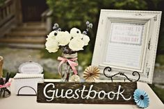 sweet guest book sign made with white paint, wood, and floral pinwheel decorations. photo by simply rosie photography. via love and lavender.