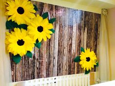 Giant crepe paper sunflowers, cardboard picket fence made a perfect backdrop for the spring themed baby shower.