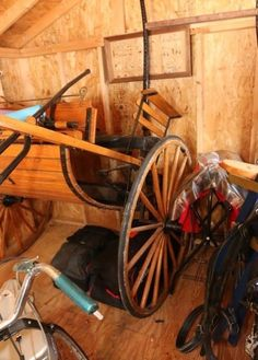 """Two person single axel horse drawn carriage with lime green 36"""" diameter wheels 59"""" wide and a mesh front. With one set of spare wheels 45"""" diameter. Excludes other lots."""