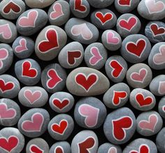 Heart rocks: red hearts and pink hearts on gray stones