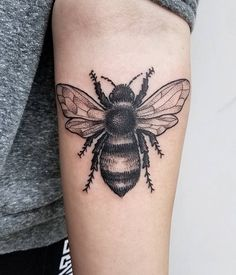 This Single Needle Bumblebee. Sitting on the arm, this bumble bee tattoo looks angry and defensive at the same time.
