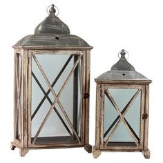 """Set of two candle lanterns with contrasting tops.  Product: Candle lanternConstruction Material: Wood and glassColor: NaturalAccommodates: (1) Candle each - not includedDimensions: 31.75"""" H x 15.75"""" W x 9.25"""" D (large)"""