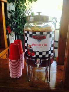 I probably won't have a Cars party but love the motor oil decoration idea for a party for my husband the mechanic. Disney Cars Birthday Party Ideas   Photo 4 of 4