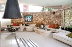This is awesome! Huge mid-century living room with the biggest sectional I've ever seen.