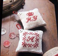 red cross stitch pincushion