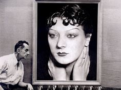 Man Ray in front of Kiki de Montparnasse's portrait