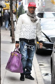A true fashion icon! Look at the purple bag