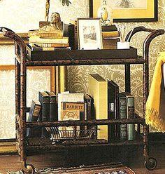 Bar cart reused as a bedroom side table.  Really nice looking arrangement.
