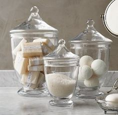 Soaps, salts, and bath bombs in apothecary jars. So pretty. http://champyandairkisses.blogspot.com/2010/10/apothecary-jarslove-them.html