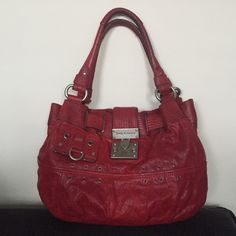 Juicy Couture genuine leather handbag Genuine leather red handbag with brushed nickel hardware. Interior has zipper pocket and 2 cell phone pockets. Tubular handle that fits over your shoulder.  In excellent condition Juicy Couture Bags Shoulder Bags