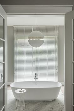 Use of blinds to make windows look like they go from floor to ceiling.