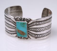 Navajo Stamped Bracelet: Heavy sterling sheet silver made of ingots pounded down and then heavily stamped and filed.  Large rectangular green turquoise is set in a simple bezel soldered to the sheet. Ca. 1920s. Photo by Jannelle Weakly, from the permanent collections of Arizona State Museum.