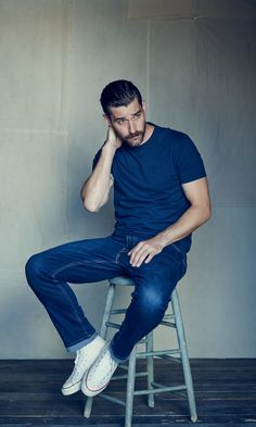 Can't get more classic than a t-shirt and jeans. Go monochrome with a navy blue tee and dark denim, paired with a pair of your favorite Converse sneakers.