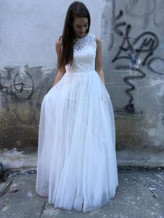 thick tulle skirt gown high neck lace bodice low laced back also available in size 6-16, other colours available. Call us to discuss your needs.