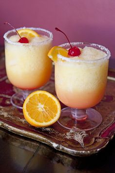 Frozen Sunrise Margaritas  when I saw these citrus cocktails I knew I had to give them a try. It's basically two cocktails in one, a frozen margarita and a tequila sunrise. Genius!  The first sip reminded me of an Orange Julius, but with a kick. The drink starts off a little bit tangy and salty but the more you drink the sweeter it gets with the addition of the grenadine at the bottom. Drizzle the grenadine around the edge of the top of the drink, and allow it to sink in the glass.