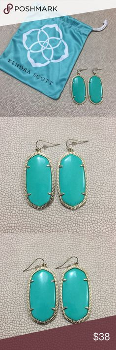 """Kendra Scott Danielle Gold Teal Drop Earrings Kendra Scott Danielle Statement Drop Earrings Teal / Turquoise stone 14K Gold Plated Over Brass Size: 2.24""""L x 1""""W on ear wire Dust bag included Excellent used condition Kendra Scott Jewelry Earrings"""