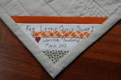 Sewn into a corner, quilt label