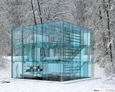 Glass Home  Architects: Carlo Santambrogio, Ennio Arosio  Location: Milan  Milanese architect Carlo Santamrogio and furniture designer Ennio Arosio didn't just stop at blue-tinted glass walls when conceiving Glass Home: Nearly everything inside this cube-shaped concept home is constructed from glass, from the shelving to the staircase to the bathtub. Even the sofa and the bed boast glass frames designed specifically for the project. Cozy!