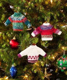 Your tree will look so warm and fuzzy once you hang some Noel Knit Sweater Ornaments on it. This free Christmas knitting pattern from Red Heart Yarn is one of the most popular ornaments of the season, and it's not hard to see why. The knitting patter Knit Christmas Ornaments, Christmas Tree Pattern, Christmas Knitting Patterns, Sweater Knitting Patterns, Noel Christmas, Free Knitting, Christmas Sweaters, Christmas Crafts, Crochet Patterns