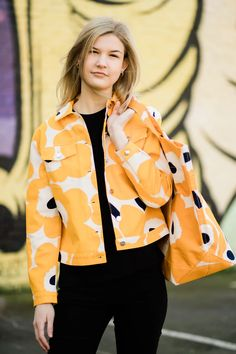 The Unikko pattern adorns the classic Sarpio denim jacket, which is made of cotton. The jacket has buttoned pockets, button tabs at the back hemline and single-button cuffs at the sleeve end, all with denim buttons Marimekko's famous poppy pattern Unikko was born in 1964 in a time when the design house's collections fe Textile Patterns, Floral Patterns, Poppy Pattern, African Textiles, Japanese Patterns, Lino Prints, Block Prints, Marimekko, Textile Artists