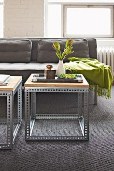 sofa tables made with vertical support bars from old metal shelving and a plywood top. OOOhh...really like these!!
