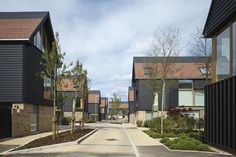 Built on the former Clay Farm site, Abode at Great Kneighton is a key part of a major new housing and mixed-use development in South Cambridge. Rendered Houses, Dormer Roof, Manor Farm, New Architecture, House Roof, Built Environment, Urban Planning, Modern House Design, Urban Design