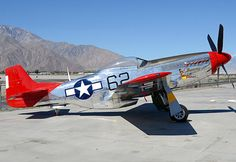 A red tailed North American P-51D Mustang.