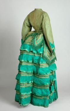There's such a gorgeous peacock inspired vibe to this moss green and turquoise hued dress from from the 1870s.