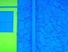 neon green and bright blue wall and door