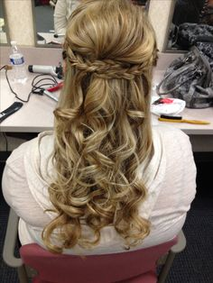 Half up half down curly hairstyle with braids & volume
