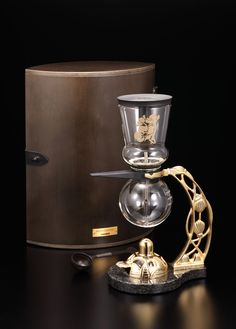 Hario's Nouveau Siphon Coffee Maker.    This beautiful unit was made for the 2010 Shanghai World Expo and has a limited production run of 200 sets    ( worldwide!)      - A coffee collector's dream